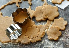 Cooking cookies with  cookie cutters. On a dark table Stock Photo