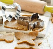 Cooking cookies with  cookie cutters. On a white table Royalty Free Stock Photos