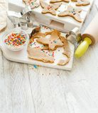 Cooking cookies with  cookie cutters. On a white table Stock Image
