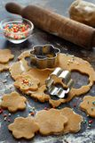 Cooking cookies with  cookie cutters. On a dark table Royalty Free Stock Photography