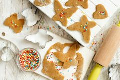 Cooking cookies with  cookie cutters. On a white table Stock Photo