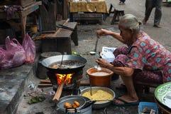 Cooking corn cakes in Luang Prabang, Laos. Stock Photo