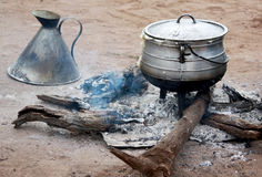 Cooking corn cereal in contrule on fire in the village, Royalty Free Stock Image