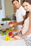 Cooking couple Stock Images