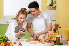 Cooking couple Royalty Free Stock Photos