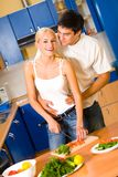 Cooking couple at kitchen Stock Photos