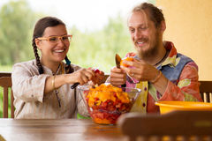 Cooking couple at kitchen Royalty Free Stock Images