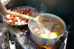 Cooking crawdads and fish over a gas burner Royalty Free Stock Photography