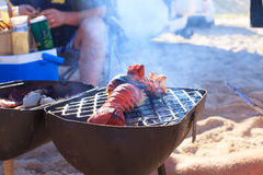 Cooking crayfish on the beach Stock Image