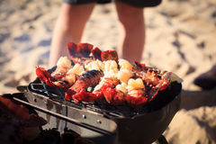 Cooking crayfish on the beach Royalty Free Stock Image