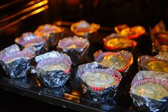Cooking cupcakes at home. Cheesecakes on the baking sheet.  stock image