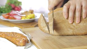 Cooking and cutting bread. In pan video footage filmed from low angle closeup stock video footage