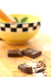 Cooking with dark chocolate. Crushed up dark chocolate for dessert preparation Stock Photo