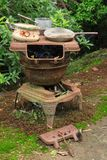 Old and rusty wood-burning stove converted into a garden ornament stock photo
