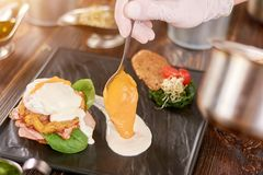 Cooking delicious benedict in restaurant. Royalty Free Stock Photos