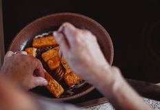 Cooking delicious fish fingers in pan stock photos