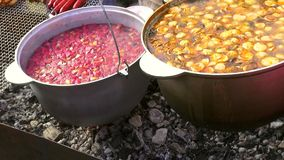 Cooking delicious food in a large cauldron stock video footage