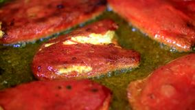 Cooking delicious fried red peppers filled in with eggs and cheese stock video footage