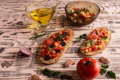 Salad sandwiches, tomato salad with olives and cucumber. Greenery. stock photo