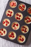 Cooking delicious strawberry muffins in baking dish closeup top Royalty Free Stock Photography