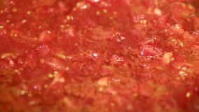 Cooking delicious tomato sauce stock video footage