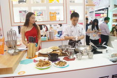 Cooking demonstration, tableware sales Stock Photos