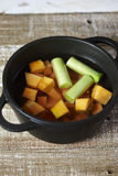Cooking diced pumpkin and leeks in boiling water Royalty Free Stock Photos