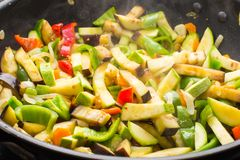 Cooking different veggies in frying pan Royalty Free Stock Photos