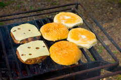 Cooking dinner on a campground grill Stock Image