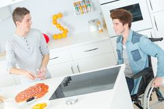 Cooking for disabled friend Royalty Free Stock Images