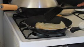 Cooking a dosa on a gas stove. Video of Cooking a dosa on a gas stove stock video