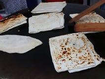 Cooking dough for gozleme on the stove. Turkish pancake gozleme stock video
