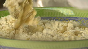 Cooking dough. View of chef add water to flour. Close-up stock footage