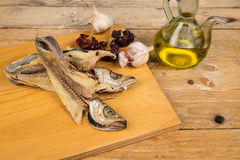 Cooking dried fish Stock Images