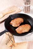 Cooking duck breast in frying pan Royalty Free Stock Photography