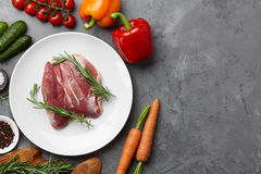 Cooking duck breast. Raw duck breast, fresh vegetables, herbs and spices on gray stone background, copyspace Stock Photos