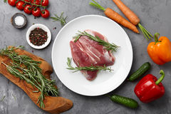 Cooking duck breast. Raw duck breast, fresh vegetables, herbs and spices on gray stone background, top view Royalty Free Stock Photo