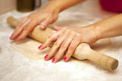 Hands with rolling pin Stock Photography