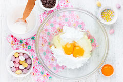 Cooking Easter cookies with crushed chocolate candy eggs ,chocol Royalty Free Stock Photos
