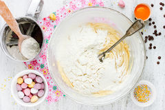 Cooking Easter cookies with crushed chocolate candy eggs ,chocol Royalty Free Stock Photo