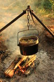 Cooking eat in bowler on the fire. Summer time Royalty Free Stock Photo