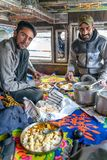 Cooking and eating view with indian drivers inside the truck stock photography