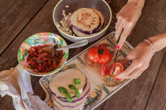 Cooking eggplant with tomatoes Royalty Free Stock Photo