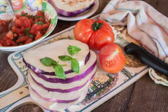 Cooking eggplant with tomatoes recipe Royalty Free Stock Images