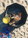 Cooking eggs on the beach.  stock photography