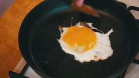 Cooking Eggs in a Frying Pan in the Home Kitchen. Cooking food at home. Home atmosphere in the kitchen stock footage