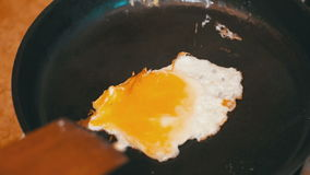 Cooking Eggs in a Frying Pan in the Home Kitchen. Cooking food at home. Home atmosphere in the kitchen stock video