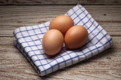 Cooking eggs napery kitchen wood teak vintage still life background Stock Image