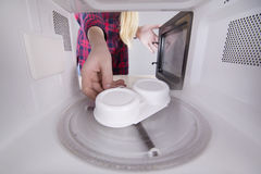 Cooking eggs poacher in your microwave Stock Photography