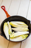 Cooking endives Royalty Free Stock Images